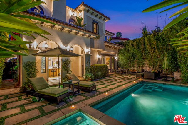 Stunning Transitional Masterpiece in South Beverly Hills. This extravagant 2013 home features a resort like pool, spa and backyard area perfectly manicured for todays buyer.  Formal LR includes adjoining office w/marble fp & steel grated window coverings. FR features wood beams, striking stone fp & floor to ceiling French doors which overlook manicured grounds. Chef's kitchen boasts 9' island & Viking appliances surrounded by glass doors leading to patio & pool.   Upstairs showcases a large  main suite w/French doors, walk-in closet, fire place & balcony & 3 en-suite bedrooms. Lower level has media screening rm w/bar & wine cooler.