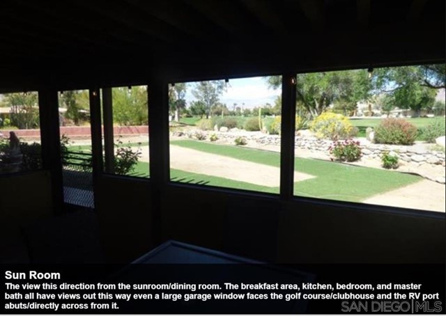 The view this direction from the sunroom/dining room. The breakfast area, kitchen, bedroom, and master bath all have views out this way even a large garage window faces the golf course/clubhouse and the RV port abuts/directly across from it.