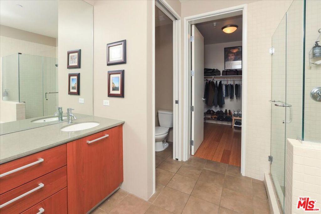 Bathroom 1- double basins, toilet and walk-in closet