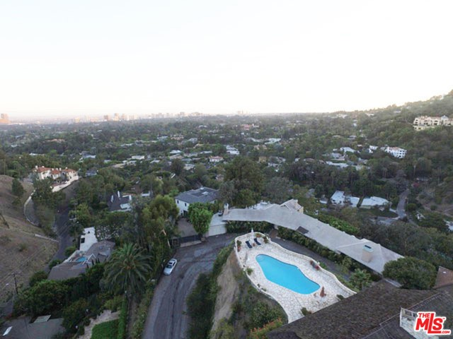 Panoramic views and exceptional development opportunity! Priced to sell! Designed by Renowned M- Rad Architecture firm, this stunning architectural masterpiece features walls of glass that showcase the stunning views. Permitted plans over 9000 SQFT with 5 Bedrooms and 6 Bathrooms. A refreshing take on contemporary design, utilizing 4 separate indoor/outdoor courtyards, yoga decks, outdoor lounges, double height ceilings, and masterfully designed dramatic pool with wrap around decks. An incredible opportunity to build on one of the best promontories in BHPO!