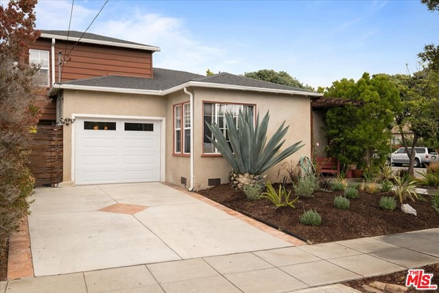 Charming traditional remodeled home in Sunset Park on corner lot.  This bright and sunny 3-bedroom home has double paned windows and hardwood floors. In the kitchen, maple wood cabinets, granite counter tops, stainless steel appliances open to the living room. The bathroom has travertine shower tiles and floors in bathroom with separate tub and shower stall. Direct access to home from one car garage and an extra parking space in front of the garage can be utilized. Plumbing was updated with copper plumbing.  Low maintenance landscaping. There are two side patio/run areas including a back patio/yard area with bright pink Bougainvillea which can be seen thru the bedroom windows and bathroom windows
