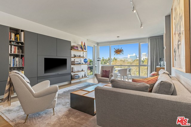 New Price!!! Welcome to the Waverly designed by world renowned Marmol Radziner. Remastered Sleek 2 bed 2.5 bath plus den with a modern Murphy bed! Open spacious floor plan with exquisite custom Modern Finishes. Beautiful custom designed kitchen and baths. The master suite has a large walk in closet and oversized spa tub. Stellar Views of ocean, park, city, and mountains. Across the street to beach, walk to shops, restaurants, & third street. The Waverly is a full service lifestyle offering 24-hour doorman, full time concierge, gym designed by Equinox, and Sky lounge. This is 5 star living at the beach!!Agent Remarks : Email for all showings with PEAD
