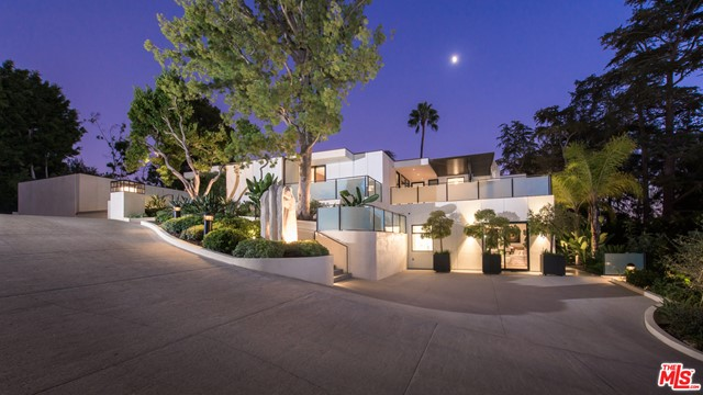 This gorgeous contemporary compound by master architect, A. Quincy Jones, has been flawlessly updated with todays best technology. Behind gates sits a serene estate complete with two spacious guest suites, both with their own private parking. The main bedroom features dual baths and closets, a second level for a gym/theater, and a terrific private balcony with fire pit. Beautiful walls of glass give way to water features seamlessly blending the outside in. Outdoor spaces offer a pool, bbq, pizza oven, fireplace, and fabulous oversized motorcourt, all surrounded by large, private flat grounds and city vistas beyond. A stunning architectural gem like no other!