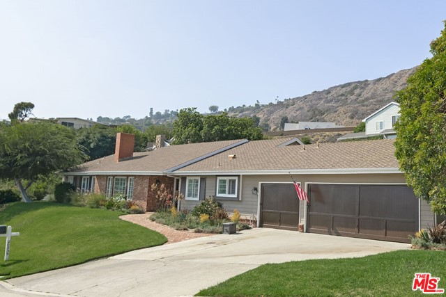 This spacious California ranch-style home is located at the end of a quiet cul-de-sac in the highly sought after Big Rock neighborhood. Less than half a mile from the beach and only 10 minutes to Santa Monica, Big Rock is perfect for those who want the Malibu lifestyle and a quick drive into town. This traditional home has retained its original ranch-style charm including large, bright rooms and easy access to a flat, grassy backyard.  The home includes a large formal living room with original brick fireplace, separate family room or office, eat-in kitchen and a generous, beamed dining room. Both the family room and dining room flow out through large glass doors to a quiet backyard, perfect for morning coffee, dinner al fresco or just relaxing. The home has five bedrooms including an expansive primary bedroom with brick fireplace and private bathroom. This home presents a unique opportunity to live in conveniently located east Malibu with a floor plan that provides plenty of room for entertaining and gracious living.