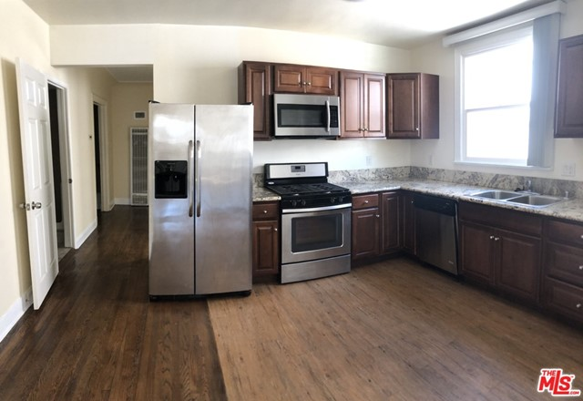 MID-WILSHIRE, Korea-Town, close to everything. Approximately 1,423 sq. ft of living space. This unit boosts 4 beds and 2 baths, All Fully renovated, Re-modeled, and updated!! RARE TO FIND parking area FOR 4 CARS. Ceiling fan in the living room. Refrigerator, Washer/Dryer in unit. Microwave, Range/Oven. Dishwasher. remote controlled Automatic gate. Available NOW, One of the 2nd floor Unit of 4 unit APT.