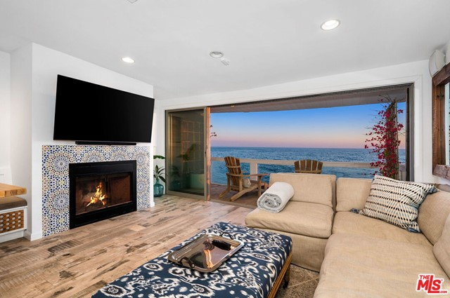 "Best Value Beach House in Malibu!  Ideally nestled in an enclave of beach homes adjacent to an idyllic sandy beach on one side and ""Moonshadows"" on the other. Panoramic white water ocean views of the majestic Malibu coastline from all 3 levels. Complete w/ 3 bedrooms, 3.5 baths and light and bright living spaces. You are immediately greeted by breath taking ocean views from the great room featuring Fleetwood stackable sliding glass doors seamlessly transitioning you to an ocean front deck. The gourmet kitchen has granite counters, Viking stainless appliances and beautiful Moroccan tile backsplash. Upstairs lies a cozy living lounge w/ custom built-ins and skylights. The expansive master retreat has a private ocean front balcony, fireplace, custom closets and a spa-like en-suite bath w/ marble counters and ocean-view shower. The lower level offers a massive 700 SF ocean front deck perfect for entertaining w/ hot tub, outdoor TV and firepit. Close in only 20 mins to Santa Monica!"
