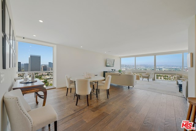 """Designer remodeled corner unit with expansive panoramic city lights and mountain views in the iconic I. M. Pei Century Towers. Recently gutted & masterfully reconfigured into an open flowing floor plan perfect for relaxing or entertaining. The raised ceilings & floor to ceiling windows on two sides of the unit allow for an abundance of natural light all day long. Additionally, the original three-bedroom unit incorporated two bedrooms into a sexy master suite with one bedroom utilized as a massive walk-in closet and """"his and hers"""" bathrooms. Sited on 4+ acres, this luxury 24-hour full service high rise complex offers guard gated entrance, valet parking, doorman, pool, two N/S tennis courts, fitness center, sauna & lovely landscaped grounds. Ideally located near Century City & Beverly Hills & some of the best shops, restaurants, parks & golf courses in the city. Buildings have recently undergone a multi million-dollar renovation. Float above LA and experience lavish living at its finest!"""
