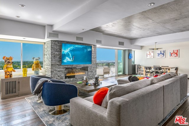 Welcome home to the ultimate conveyance of sophistication in this West Hollywood compound complete w/sexy downtown views right in the heart of all the action. Walk to and from all the best dining, gyms & bars, zoom out to work right in-between Sunset & Santa Monica Blvd. The building includes 24/7 valet & concierge waiting on your every need, an on-site dog park, gym, sauna & shower, large pool deck, pool/spa. The units open floor plan offers great entertaining space and high ceilings that lead to Fleetwood pocket doors which open up to a large balcony w/expansive city views. Hardwood floors throughout, recessed lighting and smart home upgrades. Italian marble counters in the kitchen w/high-end stainless steel appliances. No expense was spared when this unit was redone. Large master bedroom and walk-in closet, Italian marble shower with 2 showerheads & additional sexy rain shower. Start living the quality of life you deserve, this unit will sell fast.