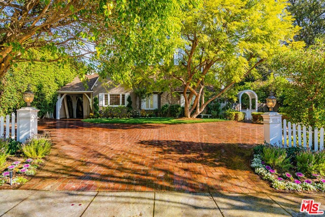 """A true description of a """"charming storybook home"""". Hard to find, just under 3000 SQFT, single level home, spread over 14,300 sqft lot. Bright & sunny throughout. Formal LR with pitched ceiling, & a wood-burning fireplace. Formal DR with a picturesque window & white wood-paneled walls. Beautifully tiled country kitchen, w/ stainless appliances, a large walk-in pantry & Breakfast area. Fab den w/doors looking out to the backyard. Huge MBR suite in its own wing for privacy. Has several closets w/built-in shelves, & a large walk-in. Adjoining sitting room, w/a wood burning fireplace, dedicated just for this romantic master suite. There are 2 additional bedrooms in the main house. 4th BR converted into a den. Spread out on 1/3rd of an acre, with lushly landscaped backyard. Large enough to add a huge swimming pool. A separate GH structure that can be configured to ur needs. An amazing buy, listed for less than land value. Short stroll to fancy shops & famous restaurants in the heart of BH."""