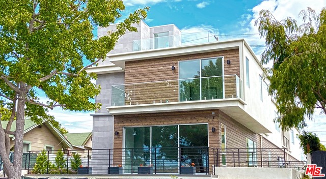 Brand new 2,770 square foot architectural townhome with a downstairs studio with a full bath and closet, plus a large roof deck with stunning panoramic views!!  This spectacular townhome feels like a home, enjoys high end finishes, open spaces, spacious main level patio, 2 car private garage w/direct access and a storeroom. Walking distance to local restaurants, cafes, shops, farmers market, Santa Monica College and a short bike ride to the beach.  **UNIT A IS IN ESCROW**