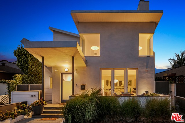 Comfortable, architectural home on a tree-lined street close to everything Santa Monica has to offer. The double butterfly roof sets this home apart and invites you through the front yard to the large porch. Designed with great attention to detail, this home features 14 clerestory windows illuminating the interior with natural light, wood floors adding warmth, built-in custom cabinetry, and an open floor plan that flows from living to dining to the kitchen. French doors open from the front porch to the living room with two-story ceilings, ample wall space for art, and fireplace. The kitchen has a breakfast bar, tons of storage, and high-end appliances. The main floor includes the primary suite with a spa-like ensuite bathroom and it opens to the rear yard offering fruit trees. The gated driveway leads to the oversized detached garage. The good-sized second ensuite bedroom is also on the main floor. Upstairs youll find the third ensuite bedroom, a large airy loft family room, laundry room, office space, and a spacious deck with gas BBQ hookup and mountain views. This happy and bright home is in a great neighborhood with easy access to the beach, local restaurants, Gelsons, Whole Foods, coffee shops and all of the Santa Monica local favorites!