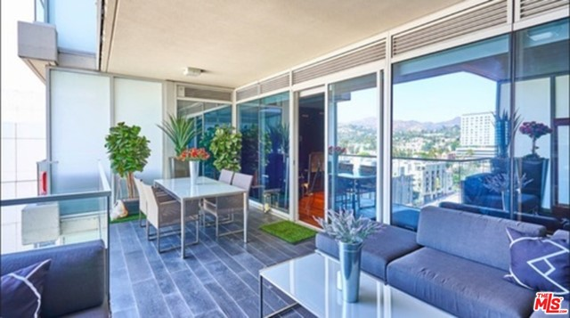 Fully Furnished with utilities, cable & internet included. Gorgeous Penthouse at The W Residences Hollywood. Stunningly sleek and romantic w/mirrored glass, soffit lighting and fireplace.  Almost 2000 sq', 2 large master en-suites, 3 bath, spacious balcony w/prime view of the building. World-famous views of Capitol Records, Pantages Theatre and  the well known Hollywood Sign. Luxury lifestyle w/5 star full service building including security, concierge service, pool, restaurant, bar/lounge and incredible 1/2 acre rooftop park & Bliss Spa. Options for Room Service and Housekeeping. 2 designated parking spaces or feel free to use our valet.