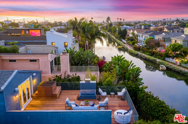 The quintessential Venice Canals home is finally available for you! Boasting sweeping views of the Venice canals, this architectural home has everything you need to fully immerse yourself in the Venice lifestyle. Overlooking the famous Venice canals and located just three blocks from the beach, this home features a carefully curated open floor plan on the main level. The bottom floor details an incredible custom chefs kitchen with a restaurant grade range/oven, dual sinks, a Sub-zero fridge and a large breakfast island.  The dining room includes a custom table to seat up to twelve and opens up to an entertaining space facing the canals with a built in bar. Continue upstairs to find four bedrooms and three bathrooms. The master bedroom suite features high ceilings, a full walk-in closet, and a large ensuite bathroom. A massive deck off the master bedroom features a Japanese style soaking tub, a gas fire pit and unobstructed views of the Venice Canals. Work from home in the fully built out office which includes and extra long custom desk and large built in bookshelves. Additional features include an outdoor shower, direct access to the canals, and a spacious two car garage with ample cabinet space. The two car driveway provides space for your guests as well. This ultimate Venice Canals home genuinely has it all.