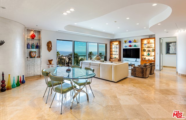 This gorgeous Santa Monica condo features 2 beds, 2.5 baths, and 1,501 square feet of chic, refreshed living space. Re-envisioned by an Italian architect and interior designer, this stunning architectural home is a contemporary retreat. The elegant interior includes honed travertine floors, magnificent ocean views, and imported Italian Rimadesio doors. The living room showcases a Venetian plaster curved accent wall, a real silver leaf built-in cabinet, Fleetwood windows, and Italian LED recessed lighting. The custom kitchen has Blum cabinetry, Miele appliances, and granite countertops. The primary suite includes motorized blackout shades and a luxe bathroom with mosaic niches, a Duravit toilet and sink, and a Toto soaking tub. The building includes a pool and a garage provides ample storage. Updated features include new electrical, plumbing, mechanical, venting systems, and soundproofing. Here, exquisite custom details and quality finishes will enchant the eyes and spirit. Located in the heart of Santa Monica, steps from the beach, 3rd street promenade, restaurants, shops, farmers market, and the famed Santa Monica Pier.