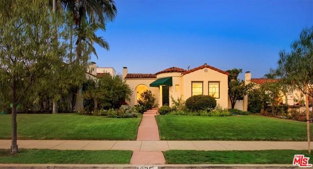 Charming beautifully upgraded single level Spanish home located North of Wilshire Boulevard. New custom kitchen with handmade tile, skylight, and Viking appliances. There is subtle but beautiful Spanish architectural detail throughout the home. The floors are hardwood, there is a wood-burning fireplace in the living room, new windows, and a new central heat and air system.  The backyard patio is covered and there is a quaint side patio, both with imported re-claimed Saltillo tile.  There are French doors and several glass-pained side doors leading to patios.  The front yard is grassy, and the back garden is a gorgeous Santa Barbara style retreat.  The detached garage fits 2 cars, with a separate carport that accommodates two additional cars.  Bathrooms are newly remodeled, high end. All upgrades were for the owner, not a flip property. The home has an incredible walking score: it is close to several grocery stores, coffee shops, restaurants, Franklin Elementary, & Douglas Park.