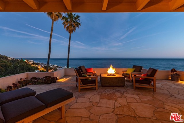 This rare, two-story, gated contemporary home is located on a private bluff in one of the most exclusive neighborhoods in Malibu. The resort-like setting overlooks the surf and coastline along the Queens Necklace and beyond to Catalina. In addition to a private primary suite, there are two large bedrooms, one-and-a-half bathrooms and a media room. In addition, a freshly updated Wolf/Sub-Zero chefs kitchen features custom finishes and natural quartzite countertops.Beautifully manicured on over an acre, the offering comes with permit-ready plans for a two-story guest studio totaling over 2,000 square feet. Also included are plans for an additional 750 square feet of decks, all with expansive whitewater ocean views. The home comes with deeded rights to the renowned La Costa Beach and Tennis Club.