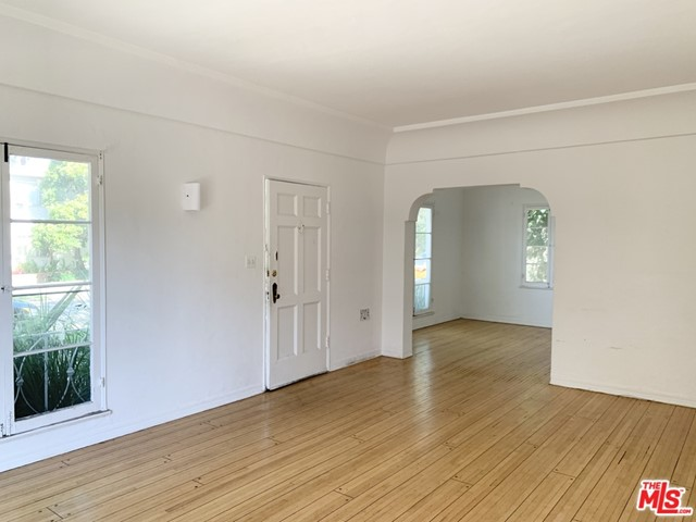 Ground level unit. Feels like a house. Personal private entry. Bright huge 1 bed 1 bath. Hardwood all throughout. Wall AC units being installed. Washer dryer laundry inside unit. Includes 1 covered parking space. Kitchen includes all the appliances you need. Bathroom has a tub. Text to view.