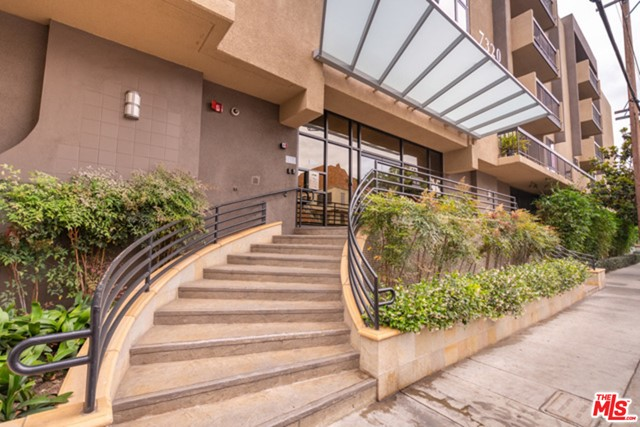 Top floor unit at the Hollywood Regis! Stunning views, just one block north of Sunset Blvd and a just a few blocks from Runyon Canyon. This well-appointed junior one-bedroom condo boasts a marble fireplace that flows through the living room's partial wall allowing an open floor plan to the dining area and kitchen. The kitchen features Calcutta quartz, stainless steel refrigerator, oven & dishwasher. Vanity, walk-in closet, and shower are all separate for your privacy. Washer/Dryer located in a large walk-in closet. Gorgeous views of Hollywood and DTLA from the living room and balcony. Resort feel with pool, spa, and a fitness center. The Hollywood Regis is one of the most secure buildings in the area, with gated and assigned parking, on-site building management & nighttime security patrols. The property will be delivered unfurnished.