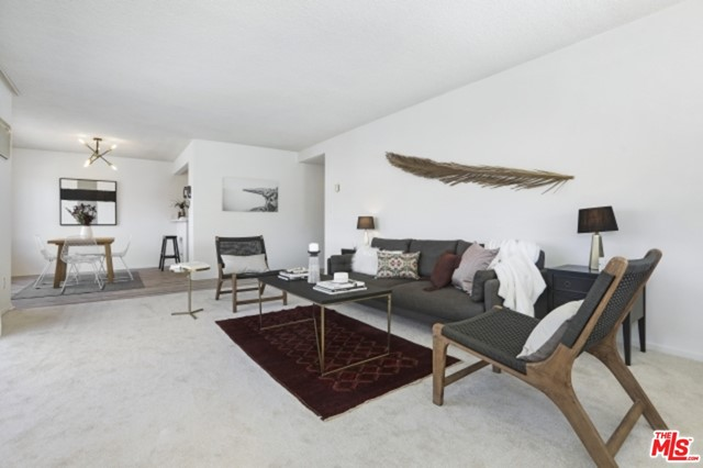 Located in the heart of Los Feliz Village, tucked in between the shops and restaurants of Vermont and Hillhurst, this freshly updated condo features all of the character of its mid-century heritage with the convenience of modern updates including a new kitchen, flooring, and updated bathrooms. All of the rooms are bright and airy with the main rooms and terrace featuring lovely views of the hills of Griffith Park.