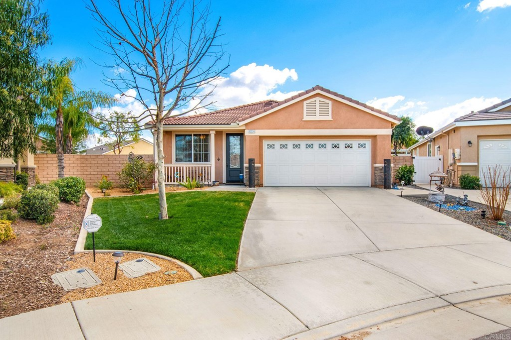 Best lot in the development!  Large 7500 sf lot in culdesac location within gated 55+ Pacific Menifee (Pacific Orchid) development.  Very light and bright home is move-in ready! Home was built in 2015 and features beechwood cabinets throughout, energy efficient windows, recessed lighting and Decora electrical switches.  Floor plan is 2 bedrooms, 2 full baths, plus a den/office which could be converted to a bedroom. Flooring is wood laminate throughout living areas with beautiful inlaid ceramic medallion in entry, and carpet in bedrooms. Master suite with large walk-in closet, large roman tub and walk-in shower.  Great room features gas fireplace with custom tile.  Inviting kitchen area with oversized granite island with bar seating, pantry, 5-burner stove, stainless steel appliances, and upgraded super quiet Bosch dishwasher.  Great room with dining area and living area which opens out to back patio. Front and back yards are beautifully landscaped with low maintenance trees, plants and ground cover.  Enjoy the gazebo in the back with built in BBQ area and firepit in cozy seating area.  Never fill up a propane bottle again! BBQ and firepit are directly connected to gas line!  Beautiful custom raised bed planter boxes for your gardening enjoyment.  Low HOA fees include pool, spa, clubhouse, workout room, and tennis court.  Low monthly solar electricity lease payment of $108/mo.  Built-in storage in attached 2-car garage, laundry room with oversize sink.  Close to all Menifee has to offer.  Senior center close by.  Freeway, shopping, restaurants, medical offices nearby.  Wine country a short drive into Temecula.  Easy access to Los Angeles, San Diego and Orange County.