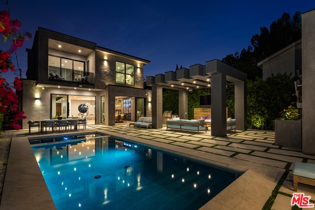 Find tranquility in this architectural oasis, situated in a premiere Venice location! Designed and built in 2019, this phenomenal home w/ a pool is a true blend of comfort, design, and functionality. Meticulously upgraded, with luxurious amenities and technology - this is an entertainers dream! //About this home: Upon entry, you are welcomed by a sprawling open floor-plan drenched in light as you are surrounded by floor-to-ceiling glass sliders and soaring ceilings. Enjoy a sleek gourmet kitchen, oversized island with built-in seating, custom cabinetry, and a separate wine cellar. A spacious formal living room transcends to the private resort-like backyard, offering indoor/outdoor flow. The state-of-the-art home theater w/ a 4K projector has been upgraded to offer the total audio/visual experience. All bedrooms tastefully designed including your master retreat, with an over-sized walk-in closet, and a spa-like bath with a soaking tub. // We Love: The integrated smart technology. Consolidated and upgraded, all electronics are on a new Savant smart system. //You'll Love: Feel as though you are on vacation year-round in the private, lush, outdoor sanctuary. Jump into the sparkling pool or unwind under the cabana. A detached studio ready to go and plumbed for a bathroom - perfect as a space for guests, your gym, or home office, and 5 parking spaces. This is paradise in the heart of the Westside!
