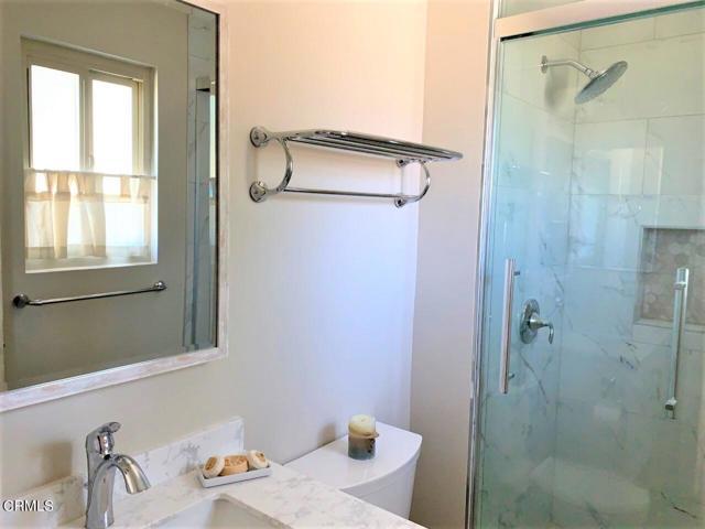 Glass & tile enclosed shower