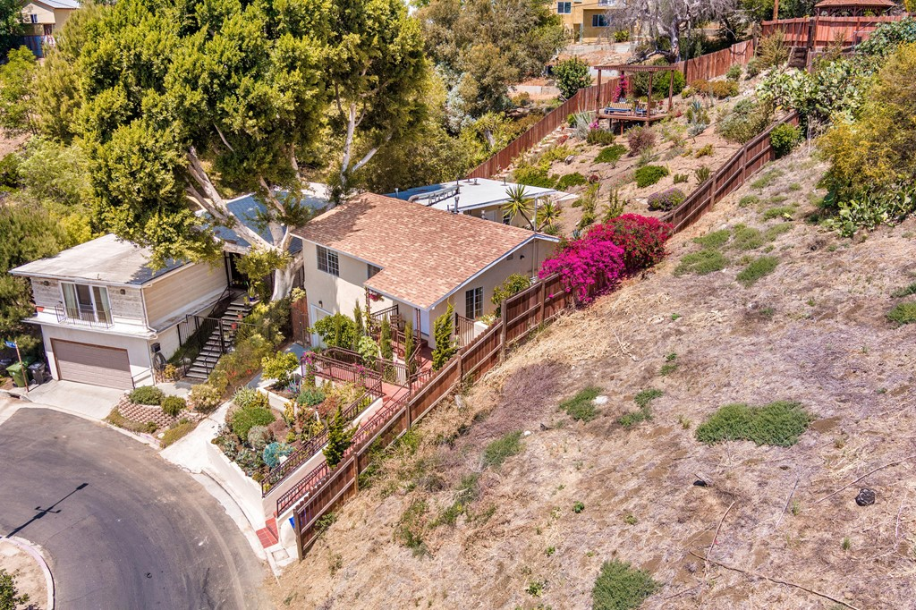 This Gorgeous 3 bedroom, 2 bath house in the University Hills area, was updated in 2017-2018 and is located on the hills above Cal State University, Los Angeles with extraordinary views including Catalina Island. The deck provides amazing panoramic views and is perfect for enjoying spectacular sunsets and the twinkling lights of the city in the evening.  A single-level home, it features the following updates: HVAC system, electrical system, copper plumbing throughout, double pane windows,  laminated dark hardwood floors and special solid stone/tile that cover the kitchen and bathroom floors. Included in the spacious kitchen are the built-in dishwasher, oven,  microwave, refrigerator, granite counter tops and mahogany stained cabinets to store all of your kitchen needs. The garage has a washer and dryer (purchased in July 2018), with lots of additional storage space. The backyard has hillside landscaping with low-maintenance native plants and succulents on a drip irrigation with Avocado, Tangelo, and Clementine trees (1 each).  Make your home here with great neighbors and enjoy being near Alhambra, South Pasadena & Pasadena shops, restaurants, plus-- it is only a quick drive to DTLA.