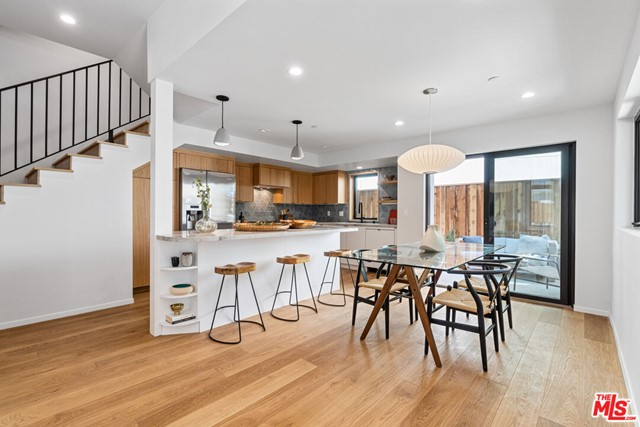 Welcome home to this impeccable, light-filled townhome in the heart of everything Santa Monica has to offer! This newly constructed architectural home, completed in 2021, is a modern retreat that beautifully blends indoor/outdoor living at its finest. //About this home: Exceptionally designed, this 2 Bedroom/2.5 Bath front unit offers a spacious floorplan and is drenched in natural light. Finished with an earth-toned, organic palette that exudes sophistication and warmth. Enter the main, open living space that offers an 11' ceiling, white oak flooring, picturesque windows with views of the lush mature trees, and an exquisite cozy brick fireplace. Designer lighting throughout and a fabulous gourmet kitchen featuring Bosch stainless steel appliances, Quartzite counters, and a stunning Tilebar backsplash. A perfectly situated private outdoor patio is an extension of your living space and is ideal for entertaining! Upstairs enjoy two spacious bedrooms, including your light and airy primary retreat with voluminous ceilings and ample closet space. Luxurious bathrooms are finished with Kohler fixtures, Bedrosian's wall tile, and in-shower skylights in the primary bathroom. //You'll Love: Your private roof deck! Enjoy the sunrises, sunsets, and ocean breezes! //The Neighborhood: Across the street from Virginia Ave Park, enjoy endless opportunities to play and enjoy the outdoors. Only 1.5 miles to the beach, a short walk to the Expo Line, the Pico Branch Library, the Farmers Market, 365 Wholefoods, and minutes to restaurants and shops on Ocean Park. This is SoCal living at its finest and an opportunity that will not last long! OFFER DEADLINE, Thursday 10/7 @ 12:00pm