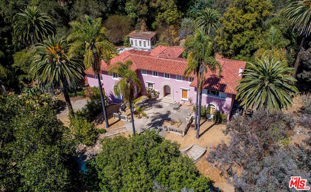 Prime Lower Bel Air, few doors from the Bel Air Hotel, walk to the hotel for breakfast or dinner, over 2 acres gated and private setting.  Ready for redoing, owner has not been here for over 20 years.  LAND VALUE. Location, location and location.