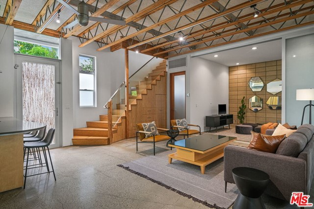 Fabulous modern loft-like townhouse with a phenomenal private rooftop deck with panoramic city and beautiful sunset views. This property is a perfect paradise for work-from-home professionals. Enter through a secure gated courtyard with gorgeous landscaping to an open flow large living room with vaulted ceilings. Kitchen complete with state-of-the-art stainless appliances and ample counter space to entertain. Dining and living areas seamlessly flow into the den/TV room. Upstairs the large master suite is flooded with natural light as well as the 2 additional beautifully appointed bedrooms. 2nd level features open air patio and wrap-around balcony with panoramic views of Venice. Direct secure entry from 2 private parking spaces into the unit. Close to Abbott Kinney with endless trendy shops and restaurants. A must see!
