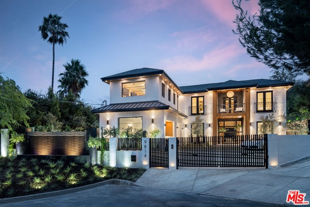 Boundless luxury encompassed by a brand-new, Modern estate, is sited on over 33k sq.ft. of pristine, gated Beverly hillside. On a cul-de-sac in the canyons, between Franklin and Benedict, just south of Beverly Park, sits your nearly 10,000 sq.ft. dream build, showcasing peerless California living in one of the most iconic neighborhoods in the city. Through a glass doorway, you are immediately greeted by a clean-cut, wooden entry foyer illuminated by a custom chandelier and museum lighting. Opulent by nature, sunlight trickles through organic Angeleno forestry and through a disappearing glass wall to paint your sumptuous living room, Miele kitchen, and fireplace. Elegance awaits in the formal dining with an original chandelier and wood-beamed ceiling. Of the 6 impressive bedrooms, the primary suite is substantially superior: Dual baths, dual closets, fireplace, lounge space, private balcony peeking out onto the city, and state-of-the art A/V system. Designed for comfort and entertainment, every room is an exquisite display of just that. Between the 300+ bottle temperature-controlled wine room, gym, office, and home theater with cutting edge technology, there isnt a reason to leave. With the Los Angeles cityscape at your fingertips, a massive backyard complete with a covered patio, cabana, wood decking, and infinity edge pool, 9814 Curwood transitions quickly from a stunning home into an idyllic destination. With a 3-car garage and additional parking for 6, entertaining is truly made effortless.