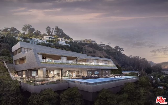 This magnificent promontory in Beverly Hills boasts the most amazing views in the city and has plans and permits approved and ready to start building. The 21,000 square foot dynamic concrete structure stands out to claim its territory amongst the great works of architecture that dot the hills of Los Angeles. The plans for the home boast 6 bedrooms, 10.5 bathrooms, full spa with sauna, steam room, and massage room, hidden speakeasy lounge, 2 barbecue areas, rooftop deck with garden and hot tub, 12 foot tall aquarium, pool cabana bar, water features throughout, library, 12 seat theater, virtual reality lounge, indoor basketball court, state of the art fitness facility with sprint turf, wine cellar, and glass tube elevator. Architecture and Design Credit: M-Rad Architecture.