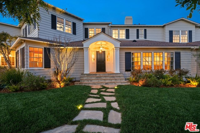Set upon a highly coveted corner lot in Brentwood, this Traditional East Coast-style estate boasts six bedrooms and seven bathrooms among an expansive 6,592-square-foot floor plan. Pairing classic details with modern flair, the home features multiple light-filled living spaces on the main level, in addition to a formal dining room and state-of-the-art chef's kitchen with an extensive butler's pantry, two dishwashers, wet bar and built-in wine fridge. Upstairs, find three spacious bedrooms, including the immense primary suite with vaulted ceiling, travertine fireplace, access to its own balcony overlooking the backyard, and two spa bathrooms with a double-size shower, jetted tub, dual walk-in closets and skylights. A true Brentwood oasis, the home's lush outdoor space is embraced by hedges and features a solar heated pool and spa, stone fireplace, built-in BBQ and pergola-shaded dining space for unrivaled relaxation or entertaining. Conveniently located just moments from San Vicente yet a seeming world away, this estate sets an entirely new benchmark for sophisticated California living.