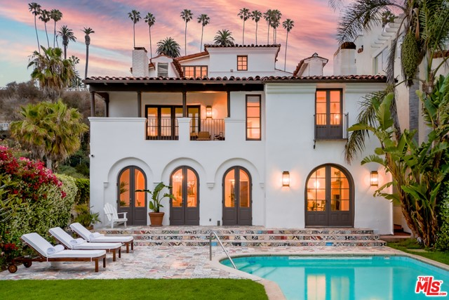 We are proud to present Villa del Sol, a stunning Spanish Colonial Revival designed by John Byers & built by Eric Barclay in 1928 for silent film star Constance Talmadge. Take a step off PCH & experience the courtyard entrance, greeted with bursts of colorful decorative Spanish tiles lining the fountain & floors, reminiscent of a Moroccan riad. The Spanish tiles serve as beautiful accents throughout the home & exterior while exposed beams, crown molding & French doors elegantly contribute to the airy, coastal vibe. The 6,485sf villa boasts 7 bedrooms (2 masters, 1 with a 13ft exposed beam hip ceiling), 6 bathrooms (including a copper bathtub) and a versatile, spacious 850sf media room. Villa del Sol spans 3 stories with a 2-car garage plus a 40ft in-ground pool & fire pit in a 2,800sf backyard that spills directly onto the beach.