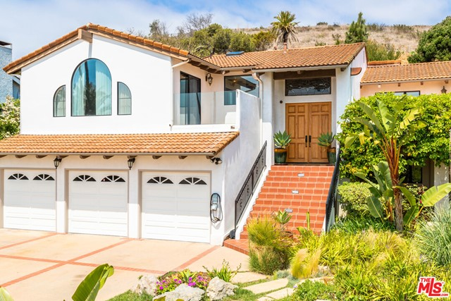 OPEN SUNDAY 2-5PM. VIEWS, VIEWS, VIEWS!! PRICE TO SELL IMMEDIATELY.  Enjoy white water views of world famous surf-rider beach from this Contemporary  Gated Mediterranean in the Malibu Country Estates. Excellent central Malibu location on a quiet cul-de-sac street. Features include a gated entry, high ceilings , five spacious bedrooms (including 2 master suites), a cooks kitchen with stainless steel appliances, formal dining room, Bonus room, three fireplaces, great curb appeal, three car garage . Nice private yard with beautiful garden and variety of tropical and fruit trees.  Superb Malibu neighborhood with street lights, sidewalks and SEWER system, adjacent to Pepperdine University with Crest Club membership for a fee, with pool, lighted tennis courts, track and more. Parking up to 9 cars . Easy to show.
