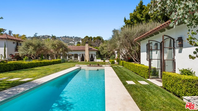 Incredible West Hollywood designer compound like nothing seen before. An oasis-like hideaway offers unique multi structure luxurious live/work options surrounded by tall privacy hedges, olive trees and extensive specimen gardens.  Set on a flat, 26,499-square-foot double lot, four structures, totaling over 9,495 square feet of living space, multiple large guest houses, gym/spa, theater and courtyards with fireplaces Evoking the romance of Montecito while incorporating incredible high quality materials and design.  The grounds include multiple fountains,  al fresco dining areas,  pool, spa, outdoor kitchen and professional skate park. Once inside the gates a private insulated world unfolds yet only moments walking to Melrose Place,  world class shopping, cafes, galleries, design districts, studios and legendary locations in Los Angeles. A one of a kind opportunity!