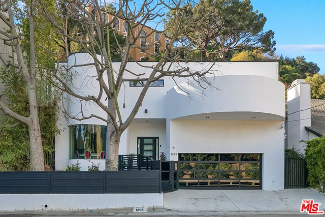 Having recently undergone a complete renovation, this contemporary smart home lies minutes from Coldwater Canyon Park, the Sunset Strip, and Beverly Hills. This home offers a thoughtful floor plan, warm interiors, high ceilings, and tranquil outdoor spaces.  The massive gourmet kitchen boasts a center island and countertops constructed from Italian porcelain and top of the line Subzero and Wolf appliances. Travel upstairs past the custom wine cellar to the Master suite that is complete with a fireplace, private balcony, oversized walk-in closet, dual sinks, a large tub and stone filled shower.  Relax or entertain in the backyard that boasts calming water features, a fire pit and outdoor spa. Coveted Warner Ave. school district.