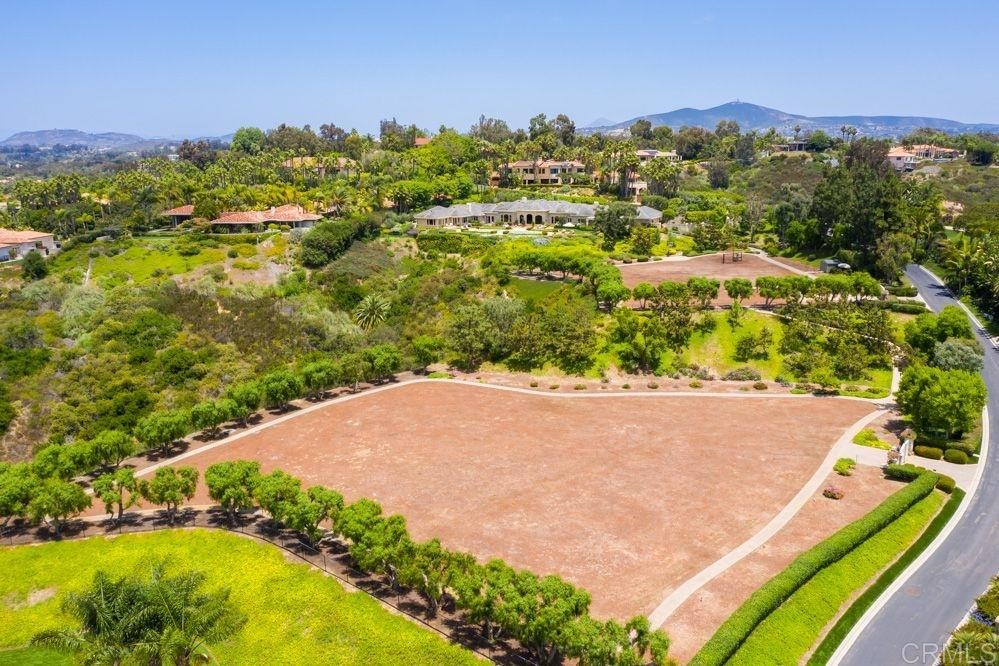 This level 2.43 acre lot is a natural compliment to the estate adjacent to the East (APN 303-041-21-00) and the adjacent lot to the East (APN 303-041-22-00) - Gated, private exclusive neighborhood - gated private drive and entrance to lot - surrounded by imported and mature pepper trees - Build an exclusive coastal compound - 4.5 miles from the Pacific Ocean - Seller would like to sell this lot with the estate (APN 303-041-21-00) and with the eastern adjacent lot (APN 303-041-22-00).