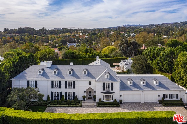 This gated classic traditional estate is located on one of the most coveted streets in Holmby Hills. Surrounded by mature hedges and a 12' solid gate, thepropertyboasts extreme privacy. The first floor has a formal 2 story entry with a grand staircase, parlor, formal living and dining room, sunken media room including a custom metal wrapped bar with onyx counters, and a private office featuring an ivory crocodile ceiling and black lacquered cabinetry. Two formal powder rooms and a spacious gourmet kitchen with breakfast and family room complete the first floor. French doors surround this classic design and open up to the expansive park like grounds with a pool, spa, 2 bedroom guesthouse and separate 2 bedroom staff quarters. On the second floor, there is an impressive master suite with an enormous balcony overlooking the backyard and 4 additional bedrooms. 219 S Mapleton exemplifies classical architecture and will appeal to a buyer with an affection for quality and taste.