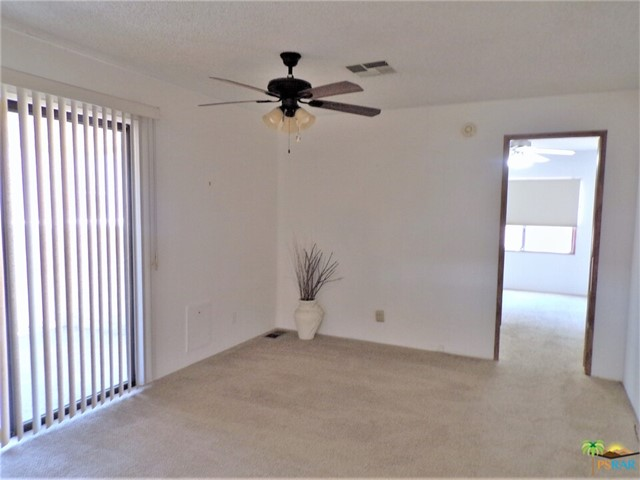 Separate Family Room Is Spacious & Has Slider Doors To e Patio