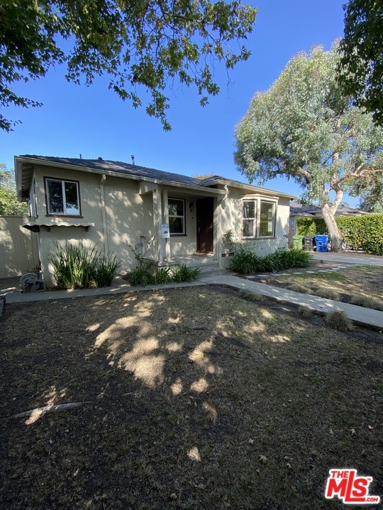 Wonderful opportunity either for development or remodel! Charming traditional home in wonderful location! 2 bedrooms 1 bathroom + step down bonus room that can be used as an office/studio or 3rd bedroom. Beautiful bay window in living room. Recessed lighting. Hardwood floors. Central air & heat. Stainless steel appliances in kitchen. New windows throughout. Separate laundry room. 2 sets of french doors leading out to spacious backyard. Close to park, beach, golf course, shopping & restaurants.