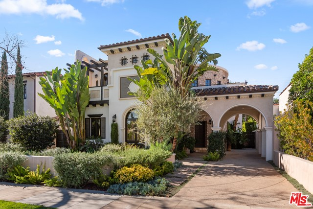 This modern architectural masterpiece, designed by fashion legend Max Azria of BCBG fame, is considered by many to be the most beautiful residence in Beverly Hills south of Wilshire. A haven of warmth and elegance, the turnkey home features a step-down living room with adjoining office, formal dining room with amazing round window and artisan drop lights, a luxurious family room you will never want to leave and an open chef's kitchen with high-end appliances, even a kosher sink. The centerpiece of all this serenity is a dramatic floating spiral staircase which leads upstairs to a curved grand hallway and four en suite bedrooms including the exquisite master, each with its own travertine tiled balcony. The lower level boasts a media screening room with built-in granite honed bar. Through wall-to-wall French doors, the home flows out onto a wonderfully private backyard with resort pool and manicured patio, perfect for entertaining and comfortable living.  Truly, this is a home like no other.  Come see for yourself!