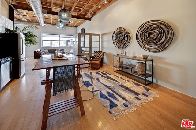Come see this airy, modern, and light-filled TOP FLOOR unit in the highly sought after Molino Street Lofts featuring spectacular east-facing views of the San Gabriel Mountains and 13-foot wood beamed ceilings. Positioned in the heart of the dynamic Arts District this is an ideal Live/Work industrial Loft accented with bamboo hardwood floors, in-unit laundry, and a modern kitchen with high-end stainless steel appliances suitable for culinary enthusiasts. The open floor plan is what we currently expect and aspire to - walk into a massive living room, dining room, kitchen combination for easy entertaining or cozy days. Meanwhile, enjoy the built-in privacy with the flex L-shaped open floorplan. The Molino Streets features a rooftop pool and lounge, sun terrace, fitness room, secured entrance, and gated on-site parking. Walk to the many restaurants/bars of Little Tokyo and the Arts district, including Bavel, Bestia, Verve Coffee, Zinc Cafe, Officine Brera, Factory Kitchen, Bread Lounge, Wurstkuche, Church & State, Urth Caffe, and more. This sunny and bright property appraises for considerably higher than its current listing price and will not be on the market for long. Your Elegant and Modern Home awaits!