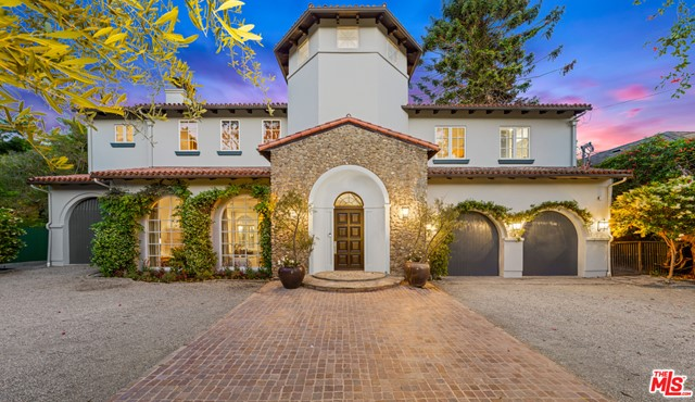 Set behind a gated circular driveway on lower Mandeville Canyon stands this stunning 8,035 SF updated Tuscan villa on over 21,000 SF lot. This private compound exudes charm and authentic details throughout. From the moment you step through the majestic arched wood door you are greeted by walls of French doors that overlook the park-like grounds. A high rotunda in the foyer and an elegant step-down formal living room. A private office, formal dining room, European style glass enclosed breakfast area, and a gourmet kitchen fully equipped to cook for 1 or 100 all open to the beamed oversized family room. 6 ensuites including a glamorous master suite with vaulted ceilings, walk-in closet, and spa-like bath with dual vanities and soaking tub. Enjoy movie nights with friends and family in the massive media room. An outdoor oasis awaits with a romantic wisteria lined pergola, large grassy area, an oversized outdoor patio and sitting area featuring a fireplace that overlooks the pool, spa and grounds which are all perfect for entertaining or eating alfresco all year long. With a 3 car garage, a one-of-a-kind elegant setting, with gracious scale and a flawless floor plan.