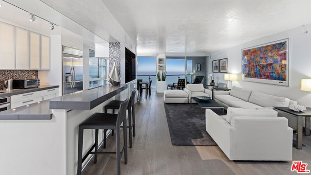 Completely reimagined 3 bed/2.5 bath unit with panoramic and unobstructed views from the ocean to downtown LA. Top of the line designer kitchen w/ Miele appliances, built in cappuccino machine, white Carrera Italian fine slabs, remote control Lutron lighting system, LED w/ surround sound, RGB mood lighting, electronic shades, Venetian plaster ceiling and walls. Ocean Towers has 5-star amenities including Valet Parking, 24-hour security, Concierge service, Pool, Gym and Spa. Walking distance to the beach, world class shopping and restaurants.
