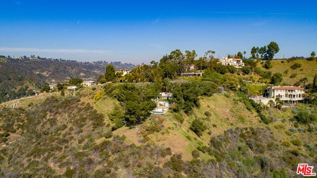 Here's an exciting opportunity to create a major Bel-Air estate in the company of some of the most important and prestigious homes in Los Angeles. With exhilarating, sweeping views of the city, canyons and mountains, this just over 13-acre-parcel is for sale for the first time in decades. The site offers unparalleled privacy and seclusion in a tranquil, natural, maturely-wooded setting with great potential to create a very special hillside manor with one of the best internationally recognized addresses in town. Bel-Air is located moments away from UCLA, Westwood and Beverly Hills and is a short drive to the Pacific Ocean. Please do not disturb caretaker of existing residence. Shown by appointment only.