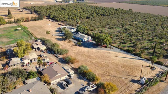 Country living close to town. Hard to find, 3 bedroom 2 bath rancher on approx 2.5 flat acres with endless possibilities. Main house 3/2, family room addition, indoor laundry, updated comp roof and tons of potential. Detached unit/storage + detached workshop/Barn with slab floor, electricity, covered boat storage. Property has Koi pond, fruit trees and views of Mount Diablo. Septic/well and water from irrigation district for landscape. Paved entrance and gravel circular driveway. Enjoy the views, privacy and room to roam!
