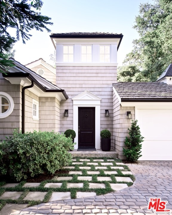 """4BR + 5BA + office & pool. This expansive, private and gated home is perched above the street in the """"Estates"""" section of old Hutton Dr.. The driveway and entrance is located on the cul de sac street, Drake lane. This tranquil and sophisticated retreat has large open rooms with intimate spaces, natural light throughout and tree top views from every window. An entertainer's dream with numerous yards and areas for outdoor living and entertaining. The living room, with 14 ft pitched ceilings, leads outdoors to the sparkling hot tub, pool and magical tree top gazebo. The well-appointed cooks kitchen has a 6 burner range, double ovens and leads to more outdoor entertaining space. The master, an oasis within itself, encompasses a sitting area, walk in closet, a generous master bathroom with double sinks and a timeless Hamptons style. Three additional guest bedrooms all with en-suite bathrooms complement this stylish and timeless residence. Close to Beverly Hills and the restaurants and shops at The Glen Center."""