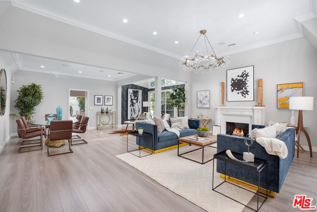 """Rare opportunity to buy into the highly sought-after """"Golden Triangle"""" North Beverly Hills neighborhood on an oversized 7650sqft lot. Fully renovated traditional style home with new designer Thermador chef's kitchen and lush private yard. Additional guest house with kitchenette + full bed and bath. Conveniently located steps from the world-famous shops on Rodeo Drive, restaurants, and nightlife including Il Pastaio, La Scala, and Mastro's. This one won't last!"""