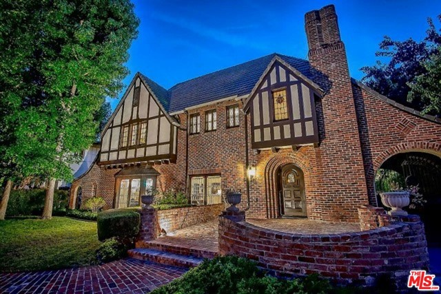 Magnificent and exquisite turn key English Tudor in Hancock Park. This property is created to entertain and enjoy living in sophistication and class. The gorgeous entry foyer leads to a step-down Formal Living Room with richly appointed fireplace. The gracious and formal Dining Room and Family Room with additional fireplace lead to an outdoor living area. This stunning residence was impeccably and entirely renovated in 2017 (new plumbing, air conditioning, electrical, roof and copper gutters.) Four wood burning European fireplace mantles. The gourmet custom kitchen with all solid wood cabinets, subzero fridge and freezer, Wolf oven, lead to an outdoor entertaining patio. Wine room and basement with temperature control for your collection. Artful and beautiful curved staircase to the landing to 4 bedroom suites and a third story playroom/office. 4 up/1down+GH apt for 6bd-7ba. Master luxury suite overlooking back yard with pool, spa, GH. Complete loveliness.